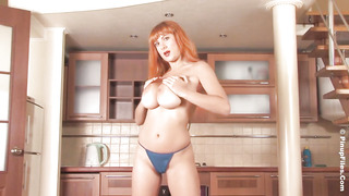 Torrid, crimson haired lady is posing in the kitchen and taunting a bit, while getting bare