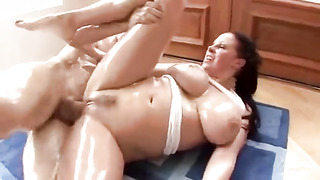 Huge-Chested, dark-hued haired nymph, Gianna Michaels is massaging her greased funbags against her paramour's rock-hard meatpipe